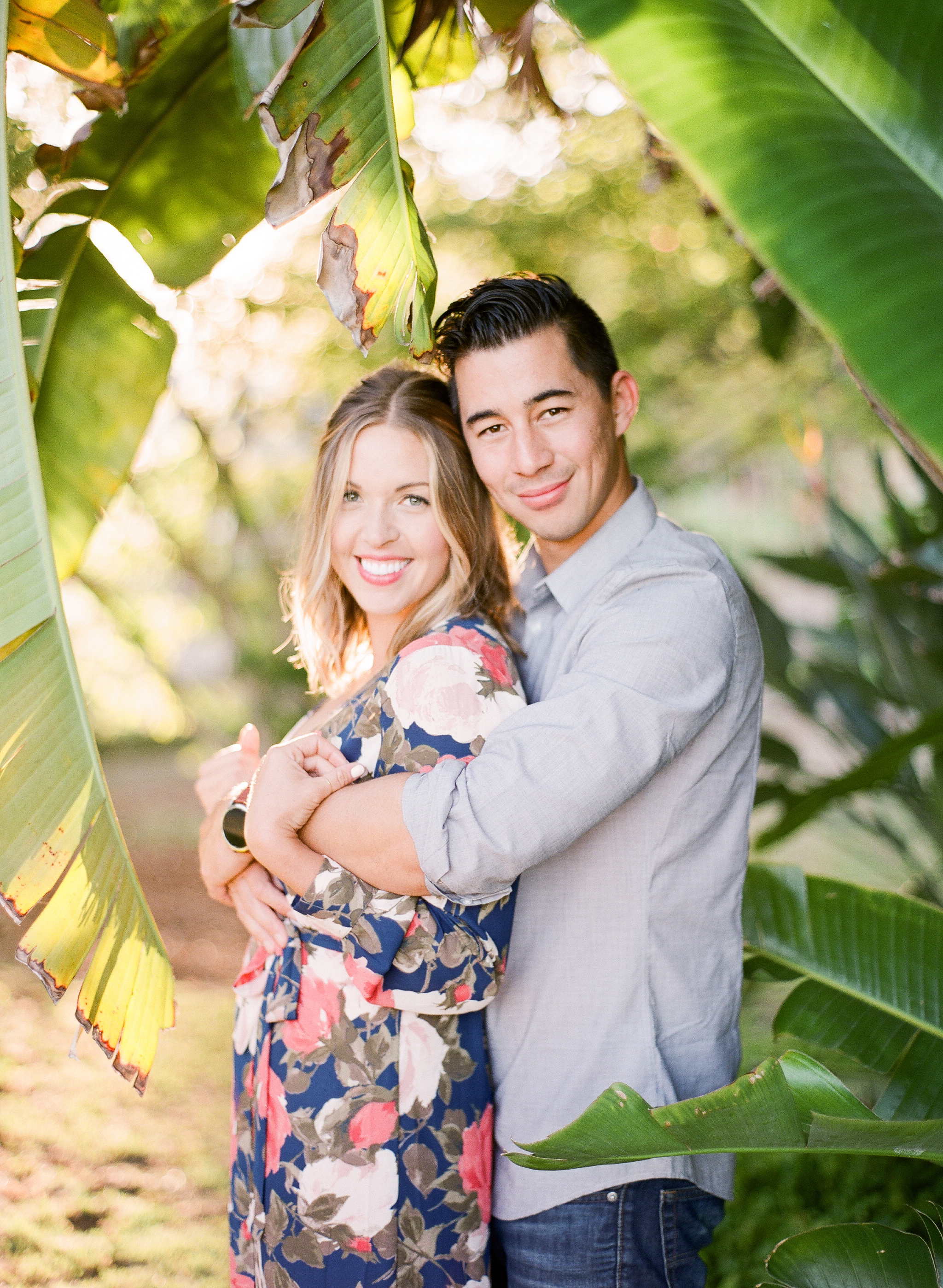 tropical engagement shoot with floral dress
