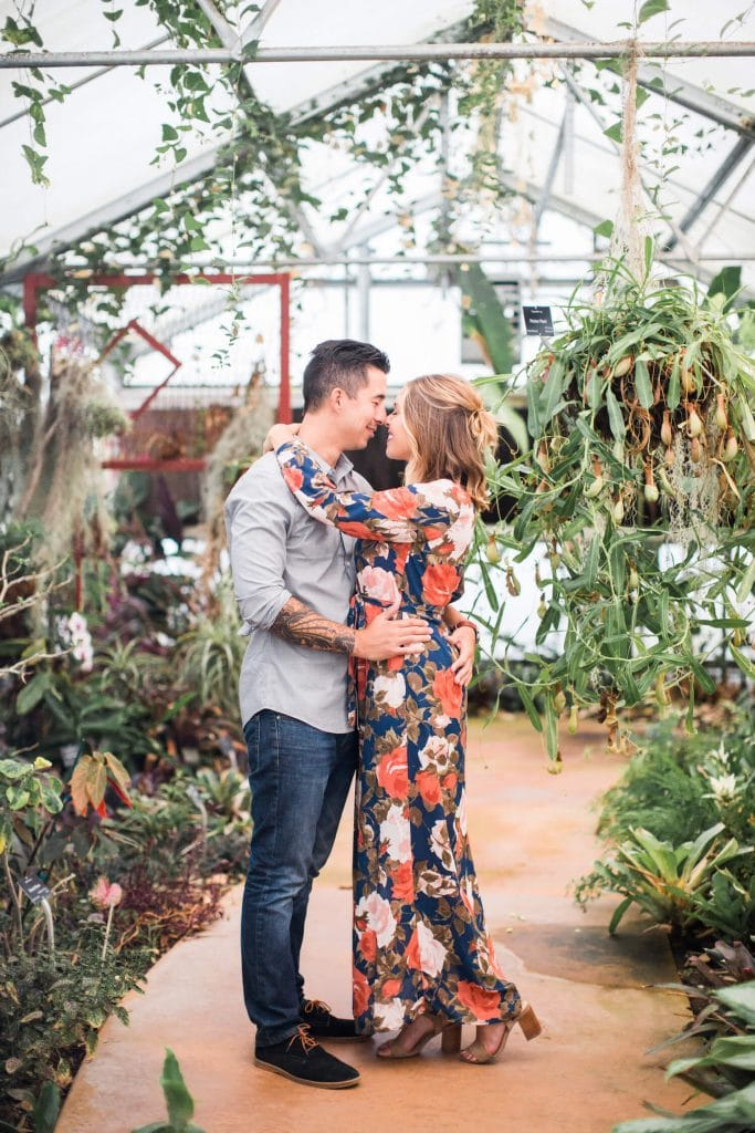Engagement photo in greenhouse