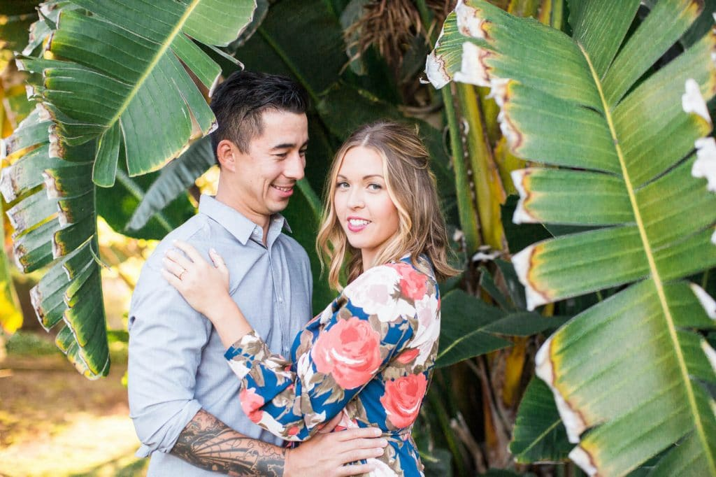 Tropical engagement photos with long floral dress