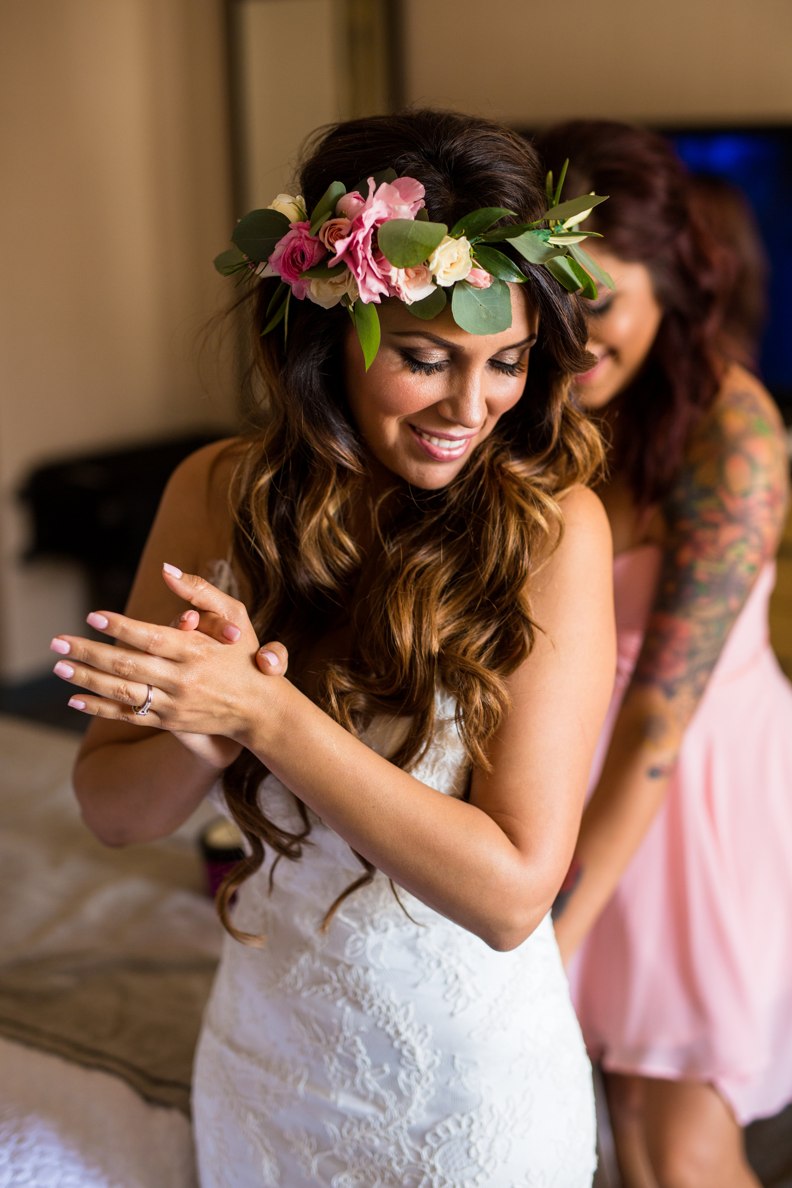 bride with flower crown getting ready