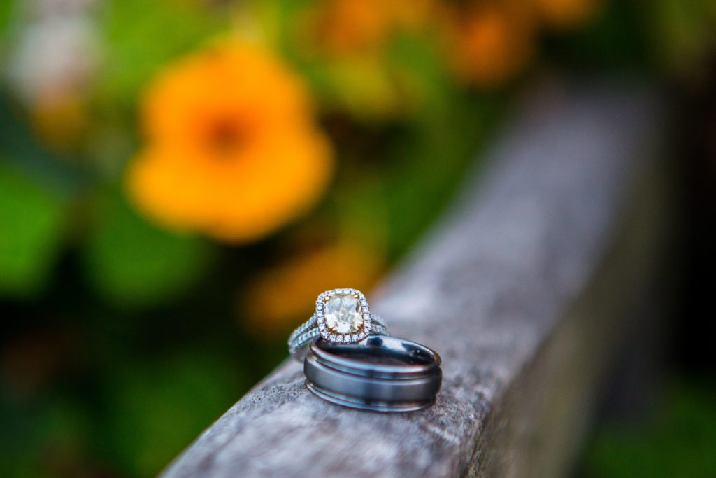 engagement ring with halo and tungsten wedding band