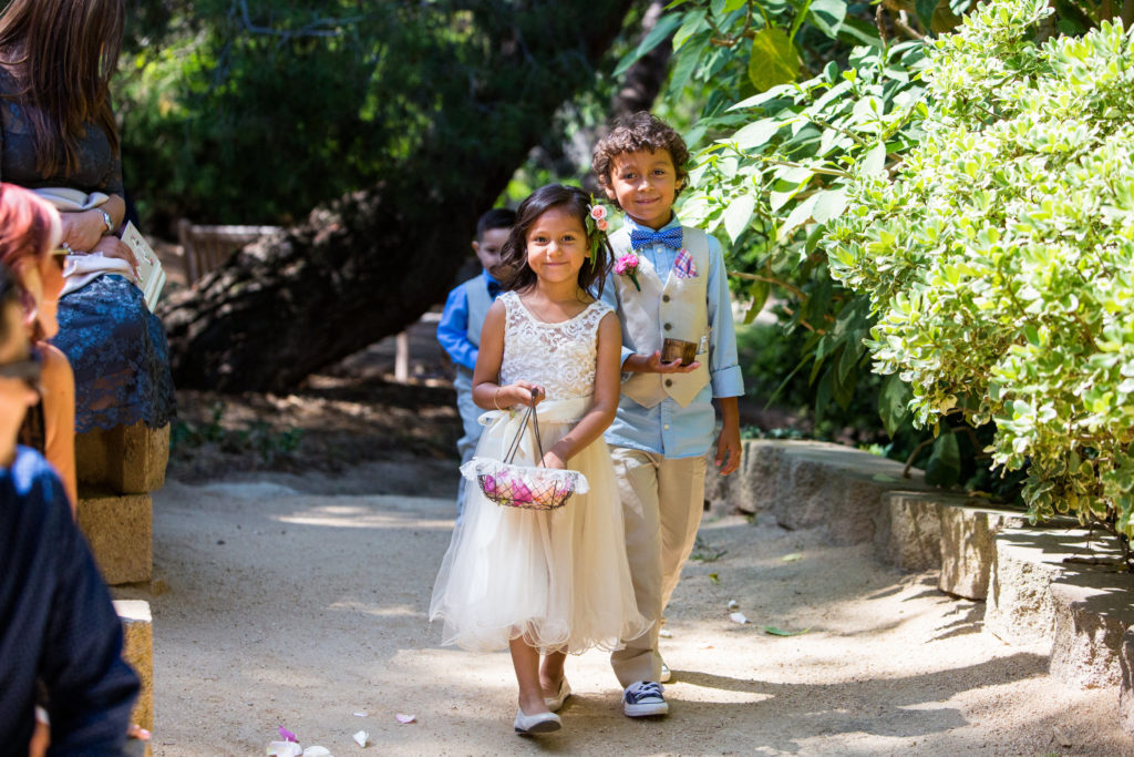 flower girl and ring bearer at outdoor ceremony