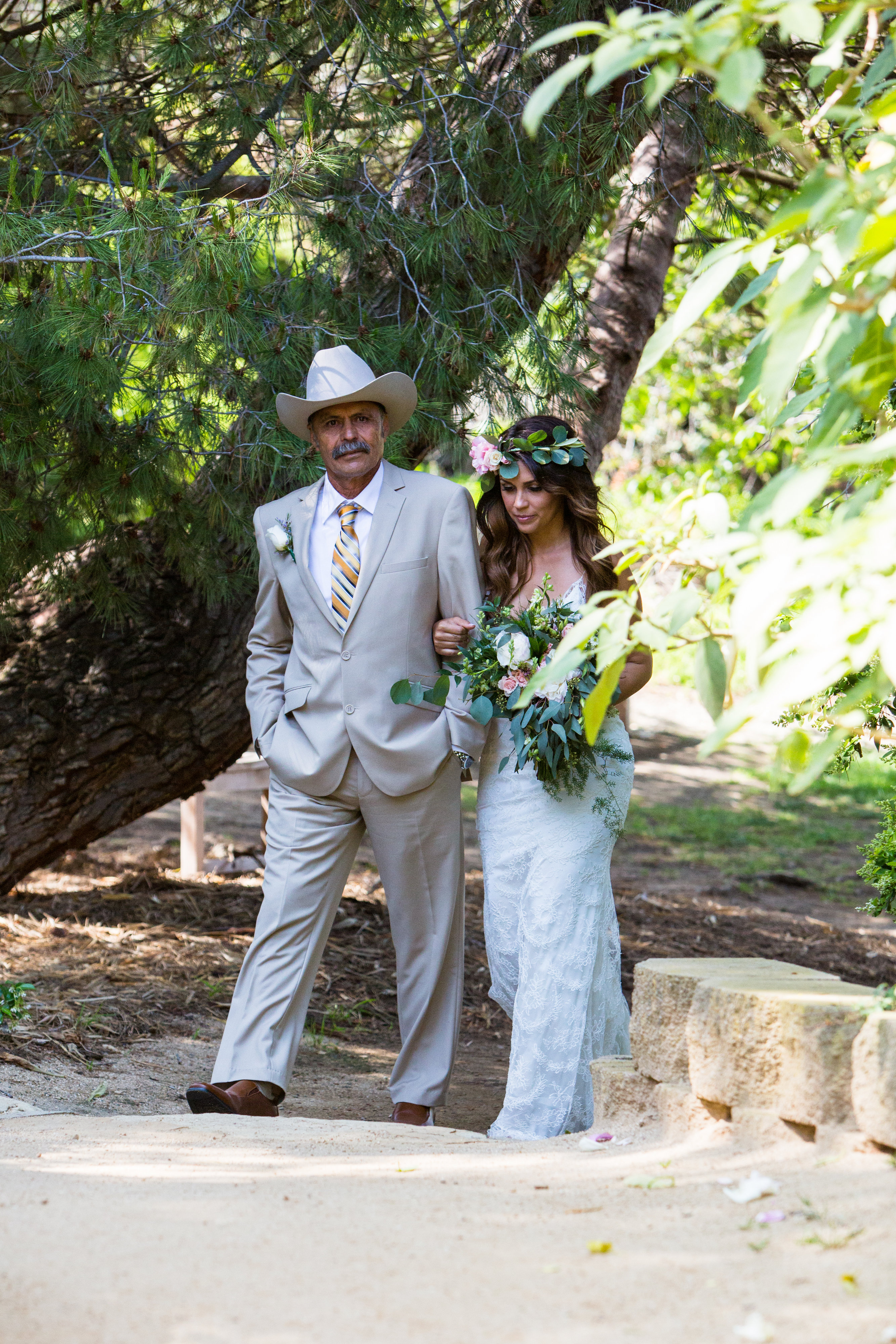 cowboy hat father with flower crown bride