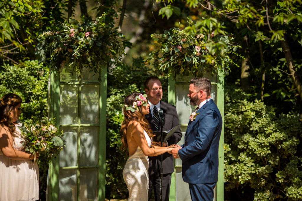wedding ceremony in front of vintage green doors by Circa Vintage Rentals