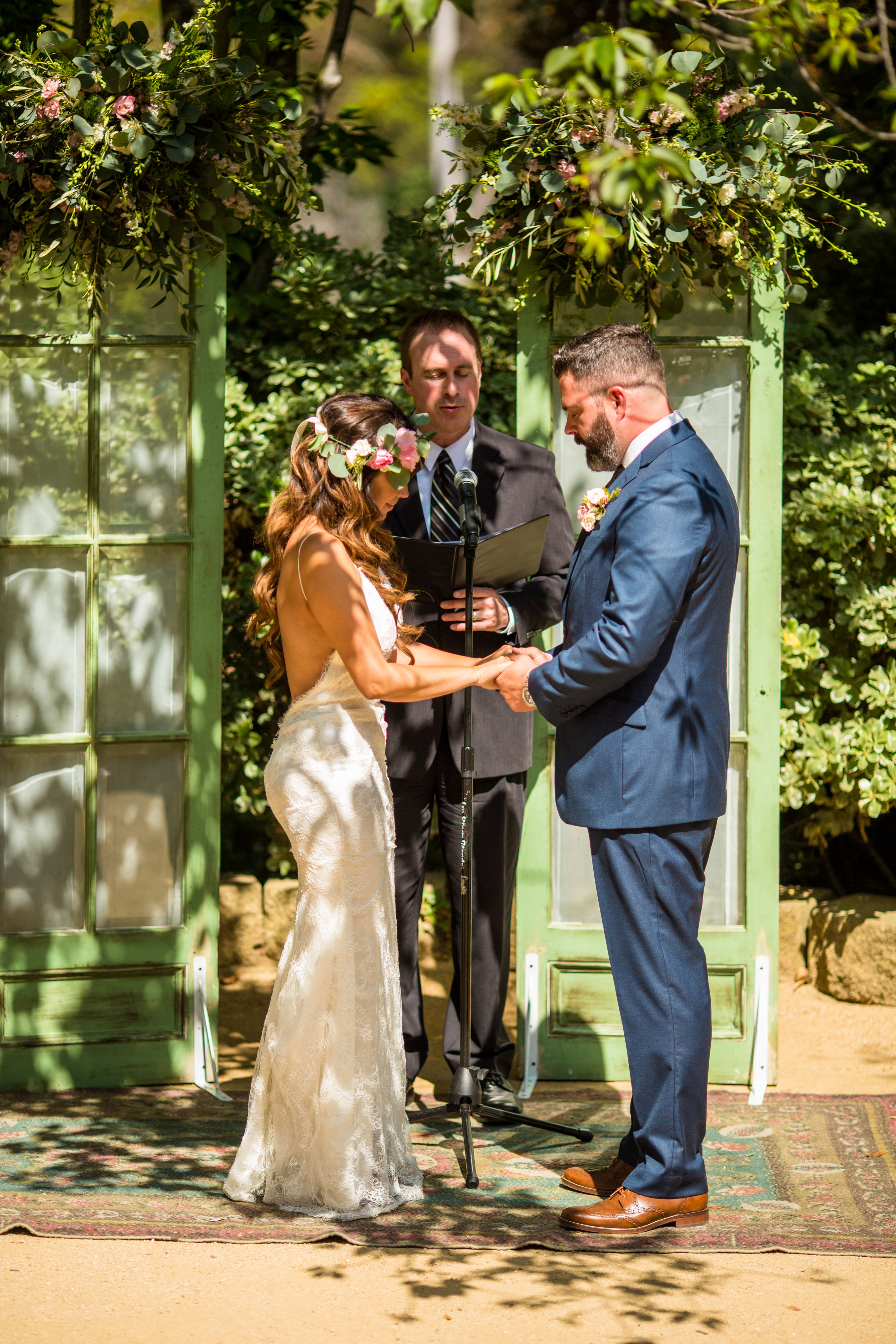 ceremony in front of vintage green doors