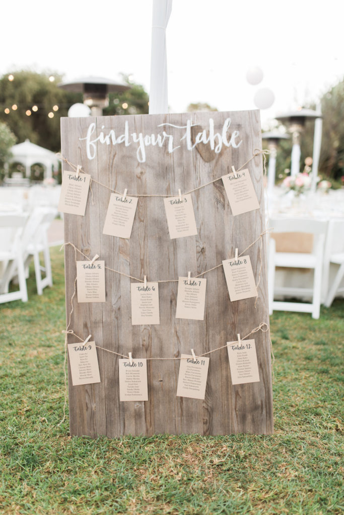 Wooden escort card sign find your table