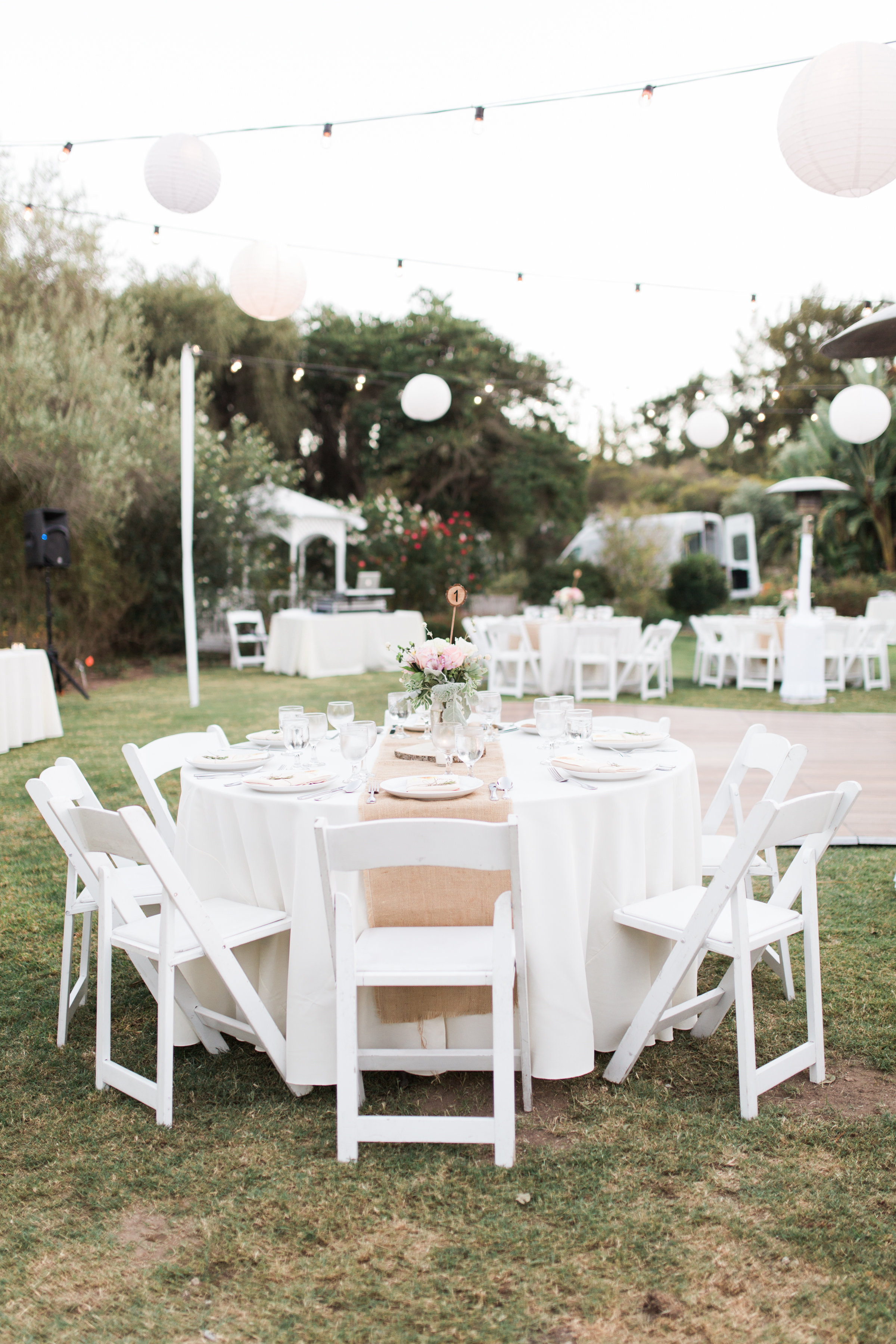 Wedding reception set up at the South Coast Botanic Garden with rustic decor