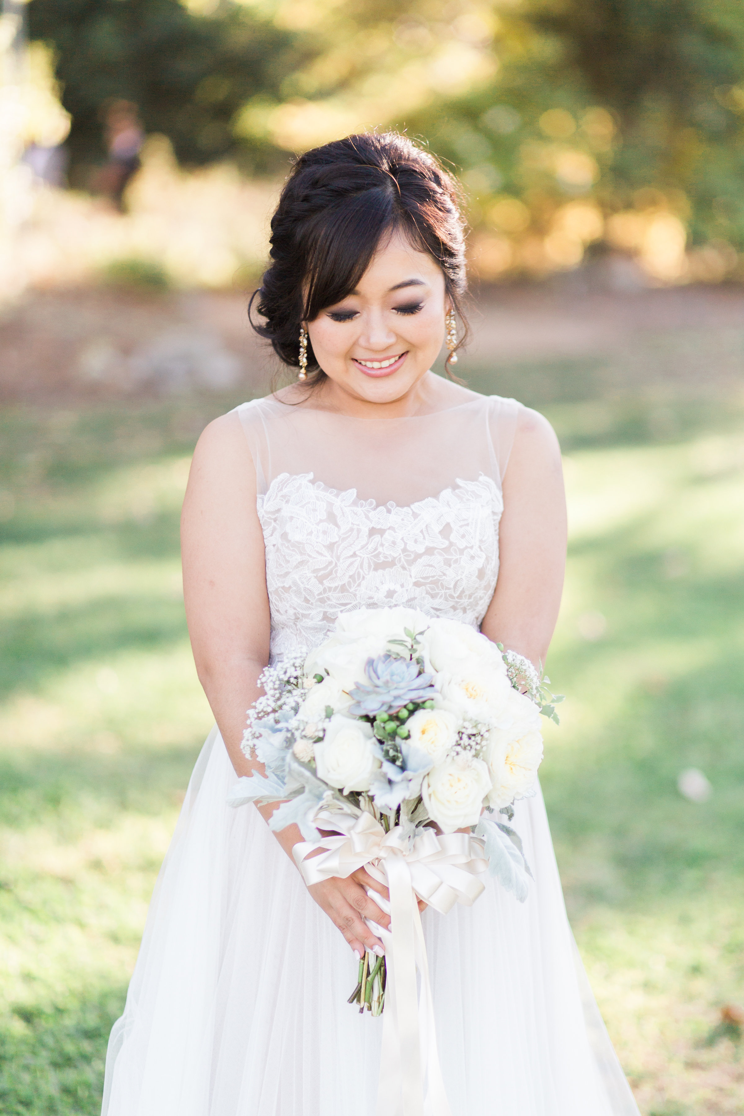 bride with succulent and floral bouquet