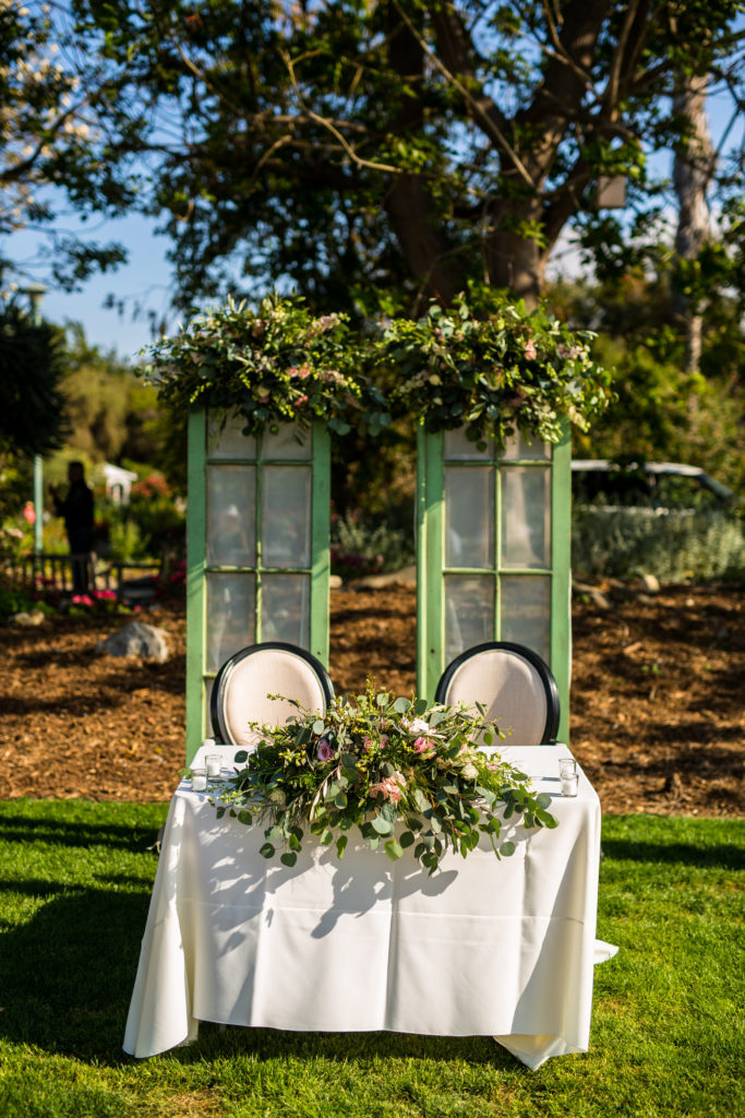 sweetheart table with vintage green doors at south coast botanic garden