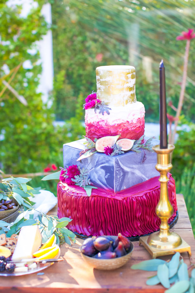 colorful wedding cake with marble and fresh figs