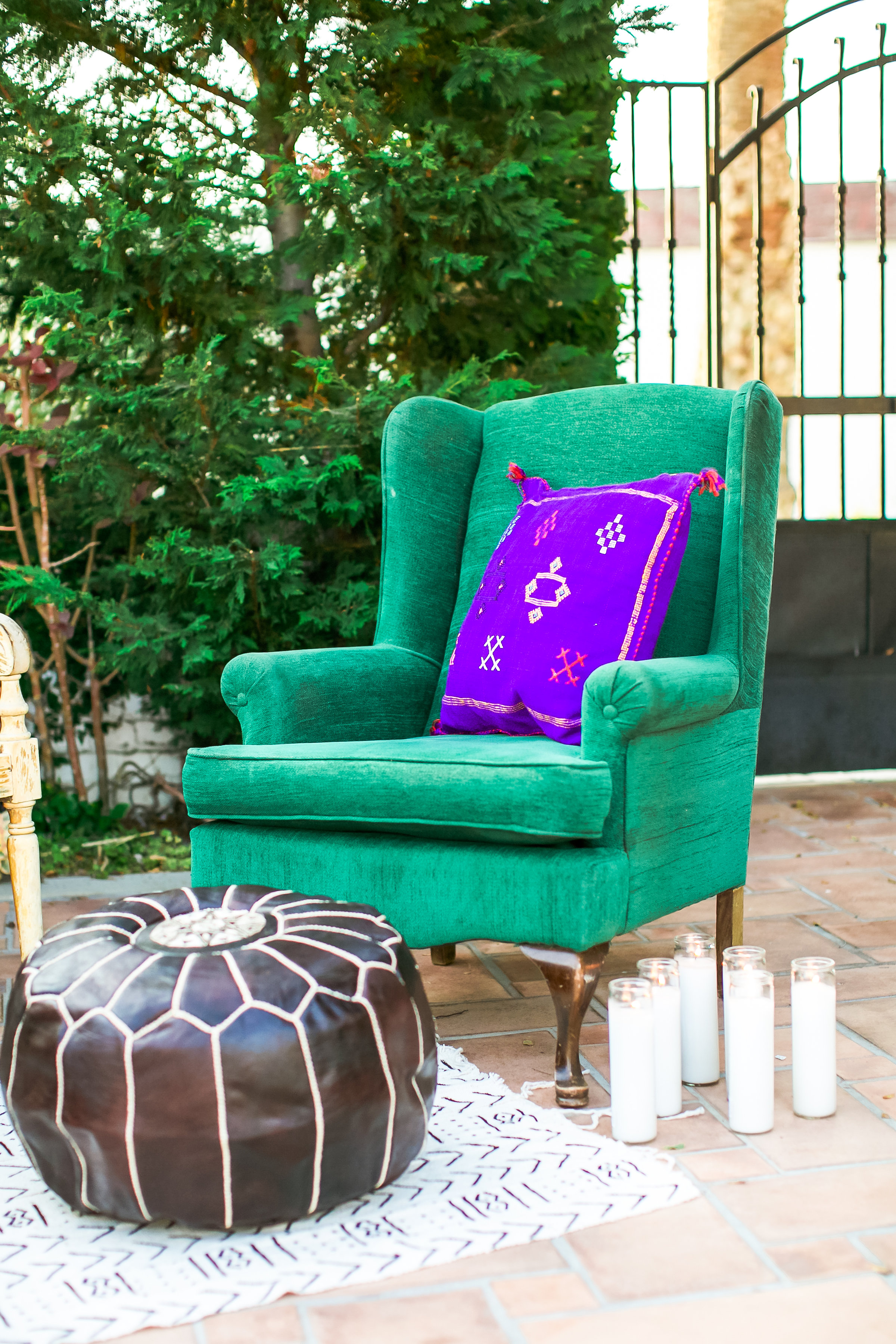 bright vintage couch and moroccan poof