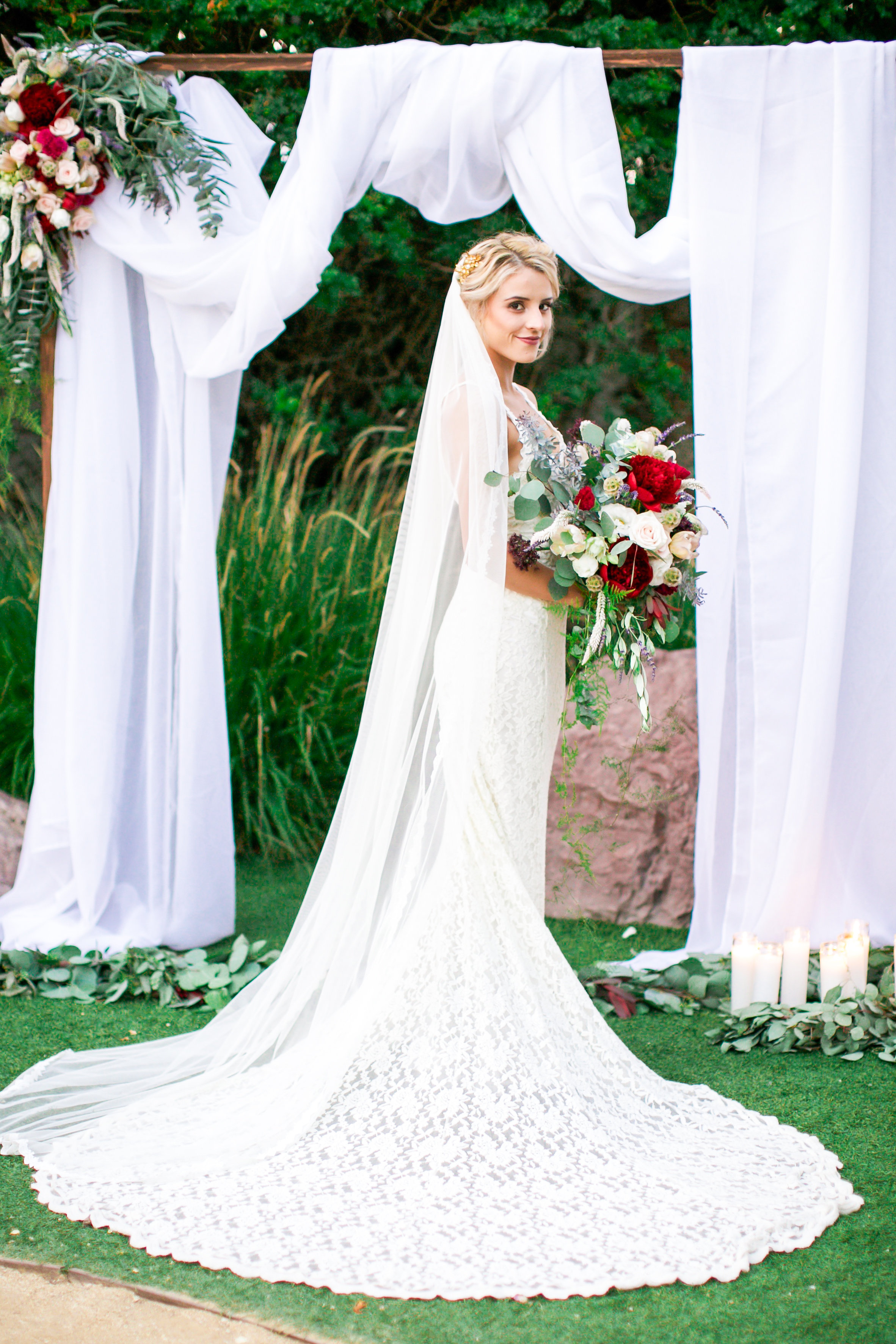 wedding chuppah with bright bouquet at casino san clemente