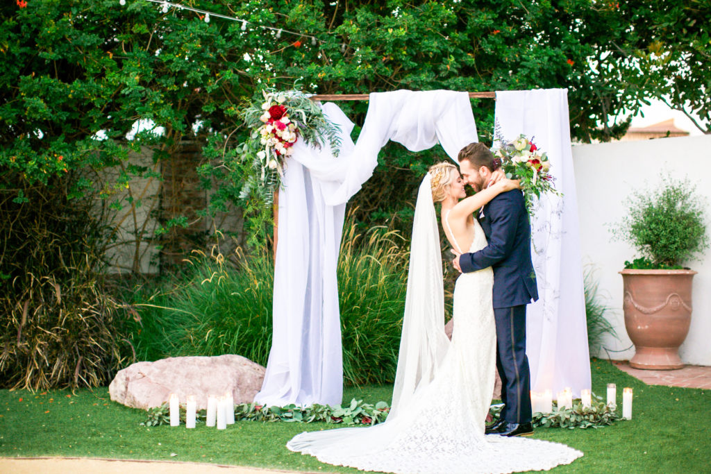 ceremony at the casino san clemente with bright flowers
