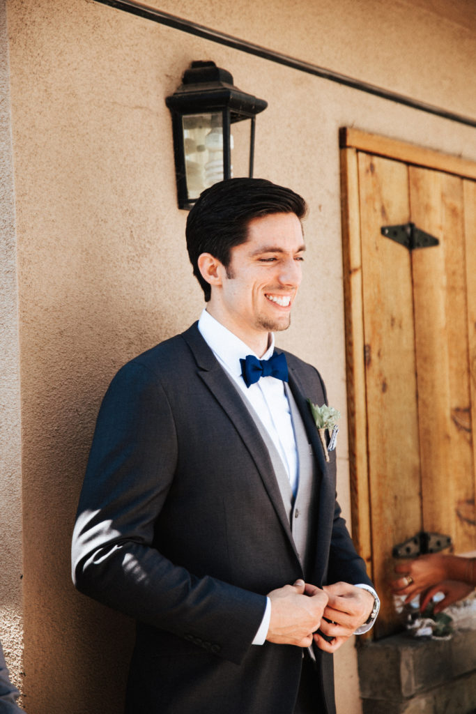 dapper groom with navy bow tie