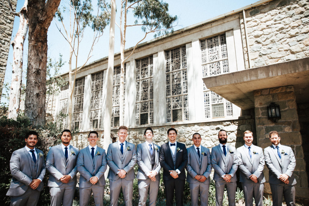 groomsmen in front of historic Santa Paula Chapel