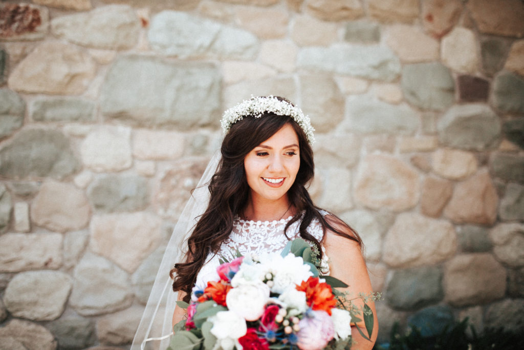 bride with flower crown and bright bouquet