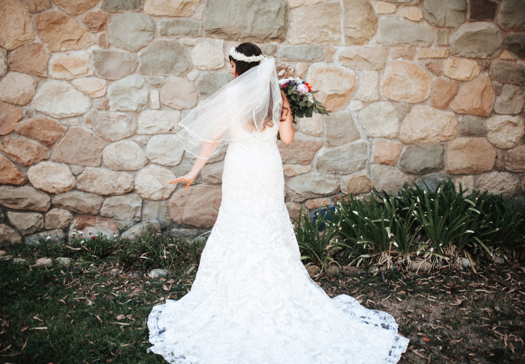 lace wedding gown and flower crown