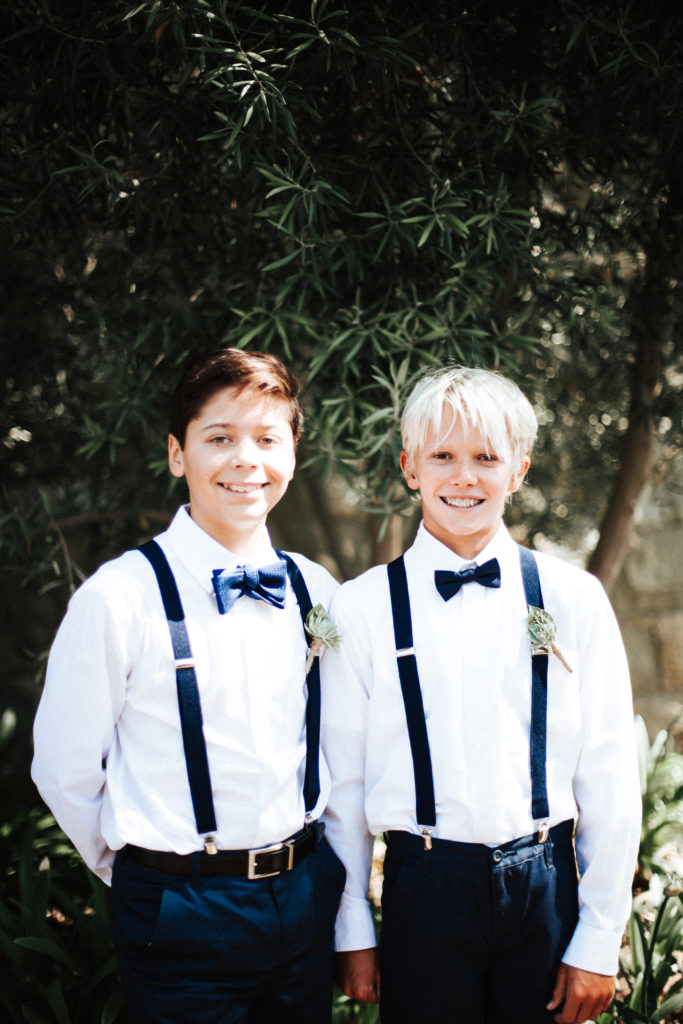 dapper ring bearers with navy bowtie and overalls