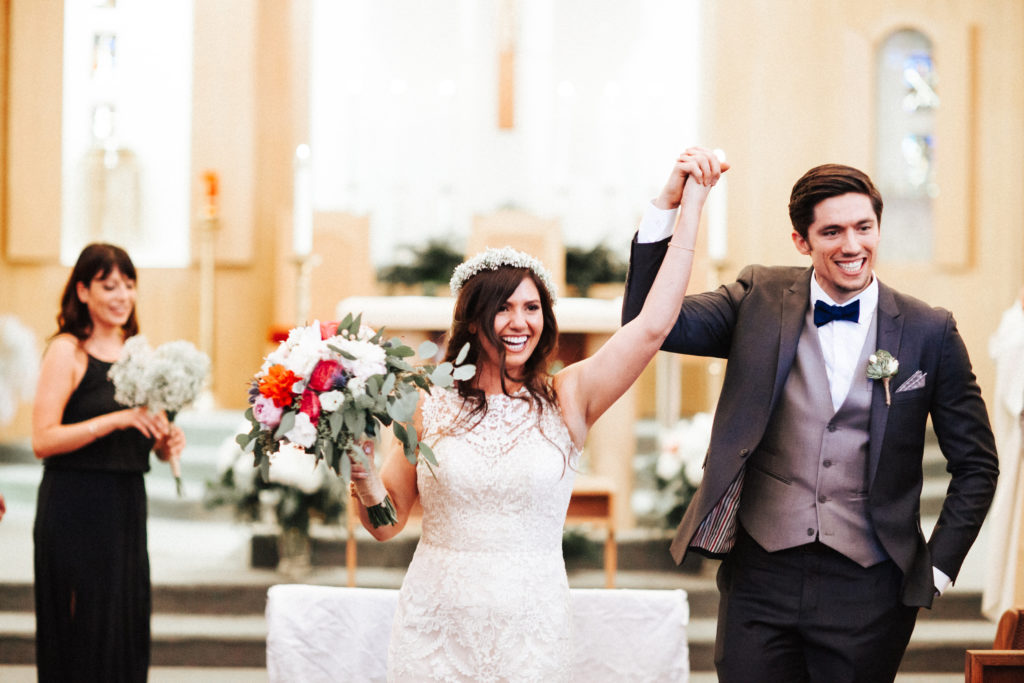newlyweds at saint sebastian church