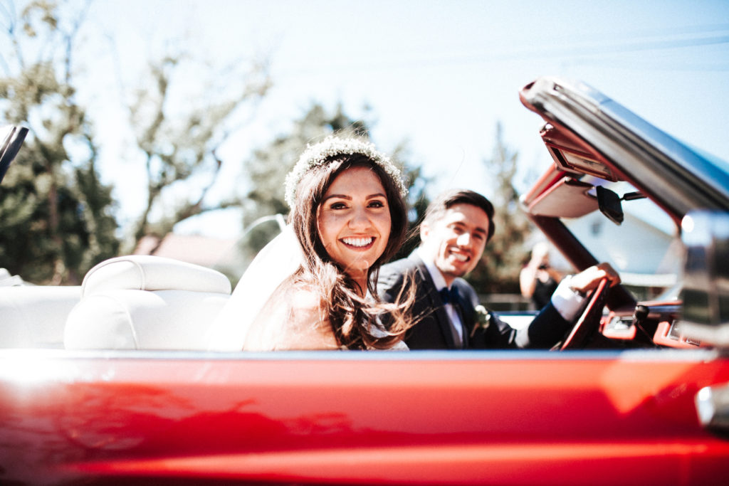 Getaway car for bride and groom red convertible