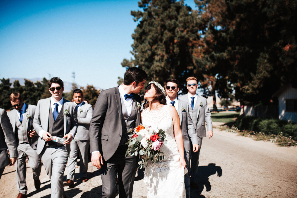 bride and groom kiss at limoneira ranch
