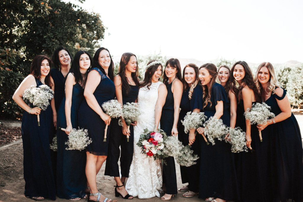 bride and bridesmaids with baby's breath bouquet