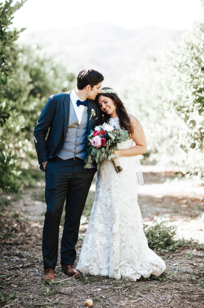 bride and groom in lemon grove at limoneira ranch