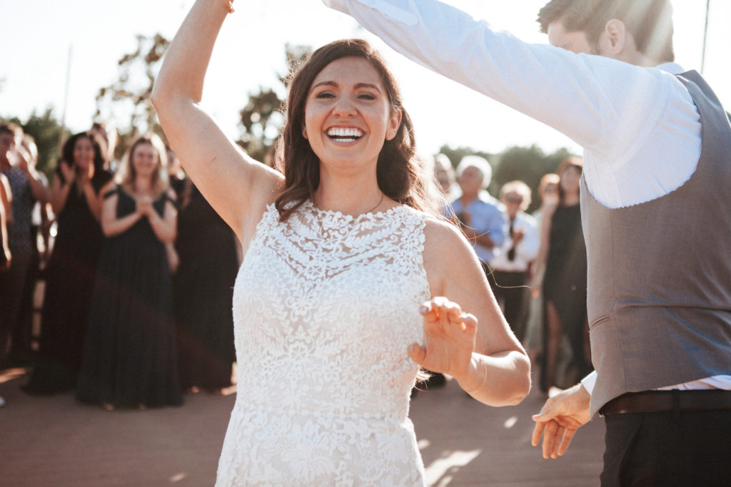 bride and groom dancing at limoneira ranch