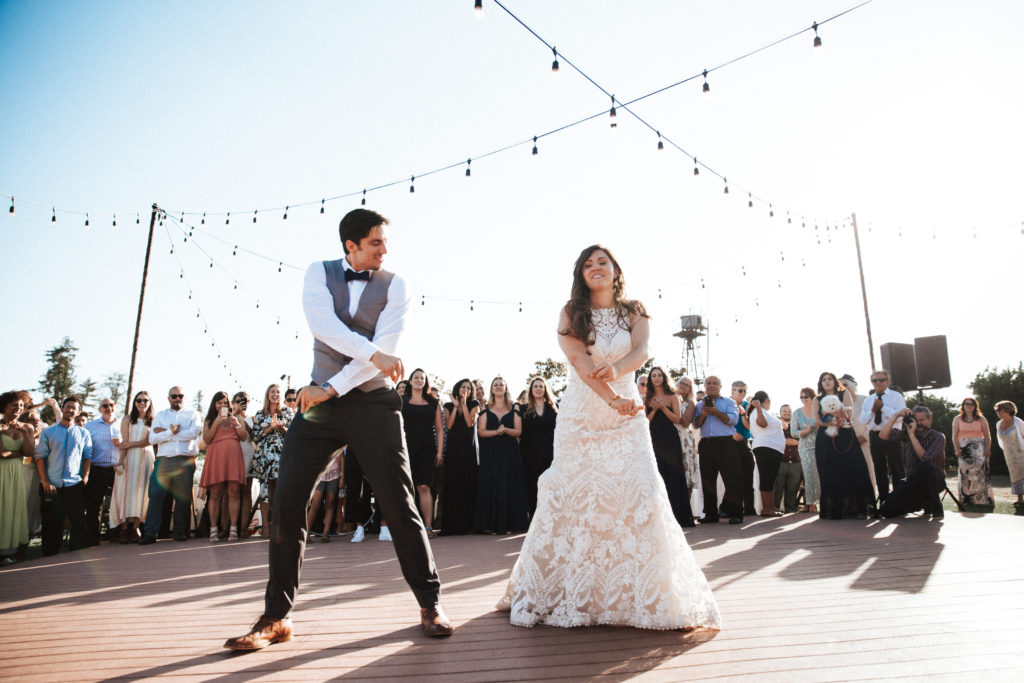fun bride and groom dance at limoneira ranch outdoor wedding