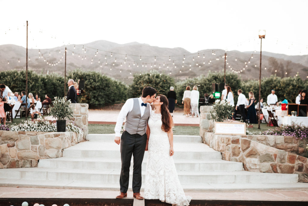 bride and groom at limoneira ranch under the lights
