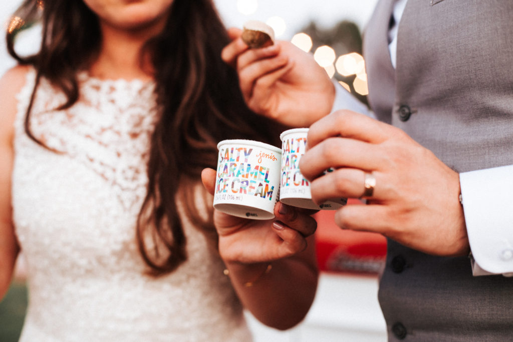 bride and groom eat jeni's ice cream