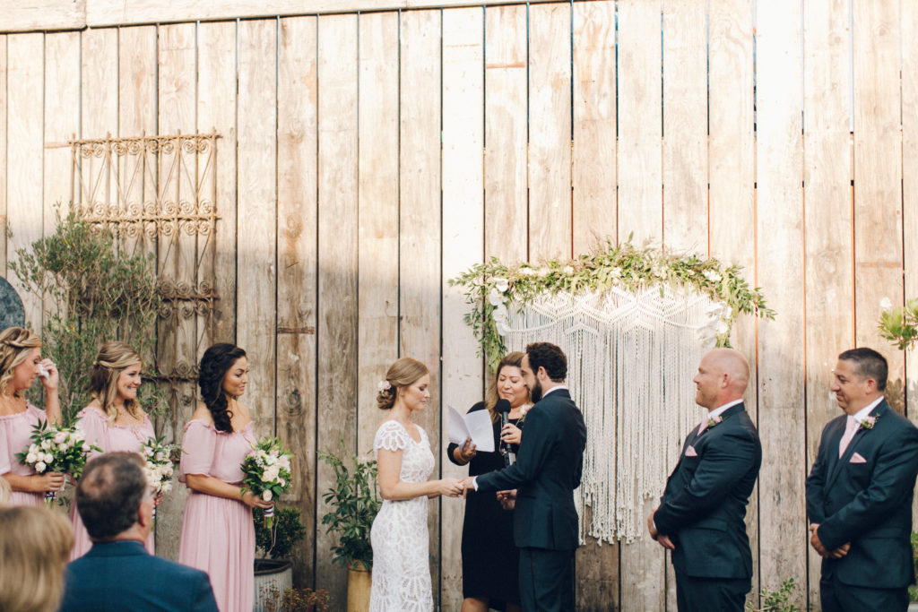 ceremony with macrame backdrop big daddy's antiques