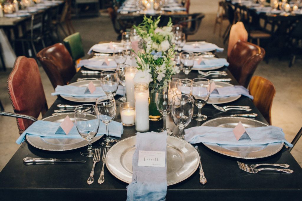 wedding reception table with silver chargers and blue dip dye napkins wedding at big daddy's antiques