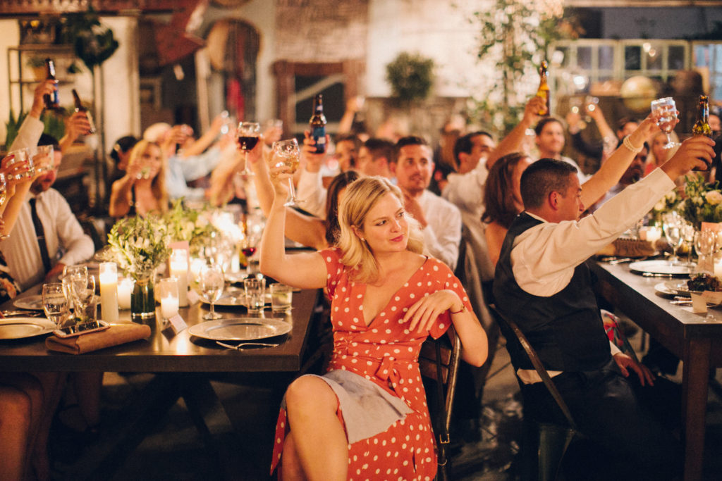 cheers to the bride and groom warehouse wedding