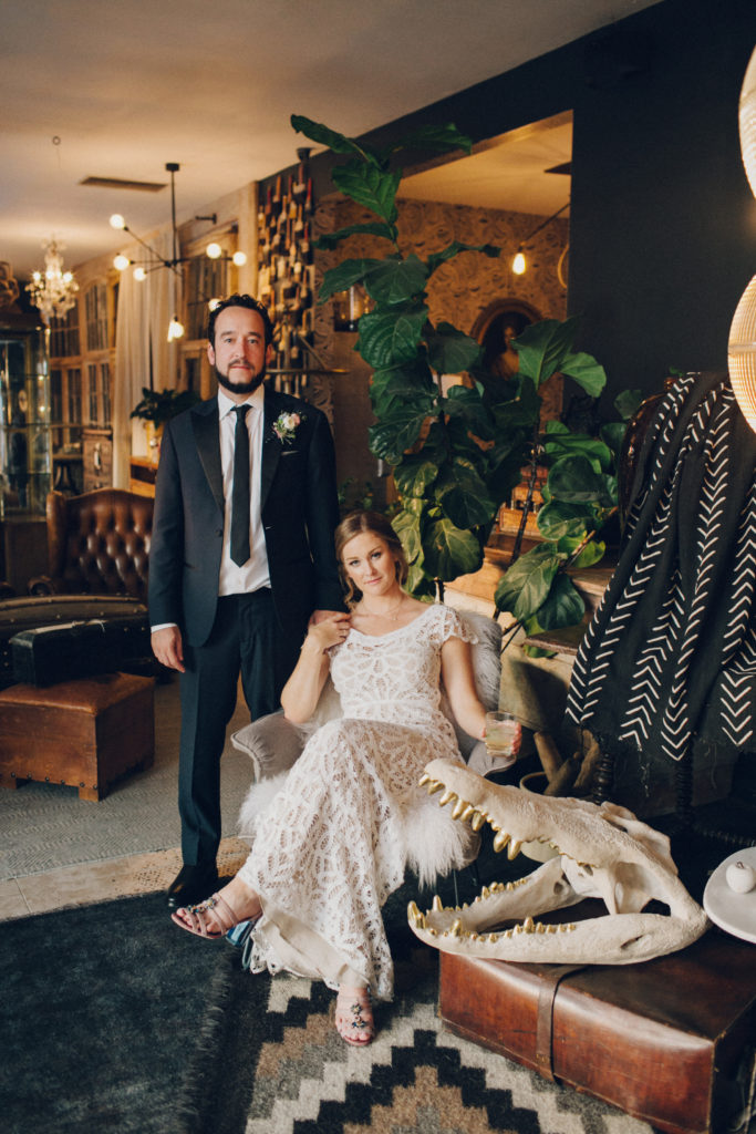 bride and groom at eclectic warehouse wedding venue los angeles with antiques