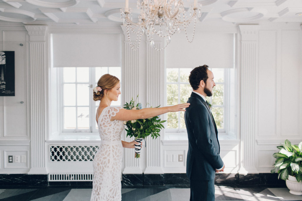 first look at culver hotel with lace dress and pink and blue flowers