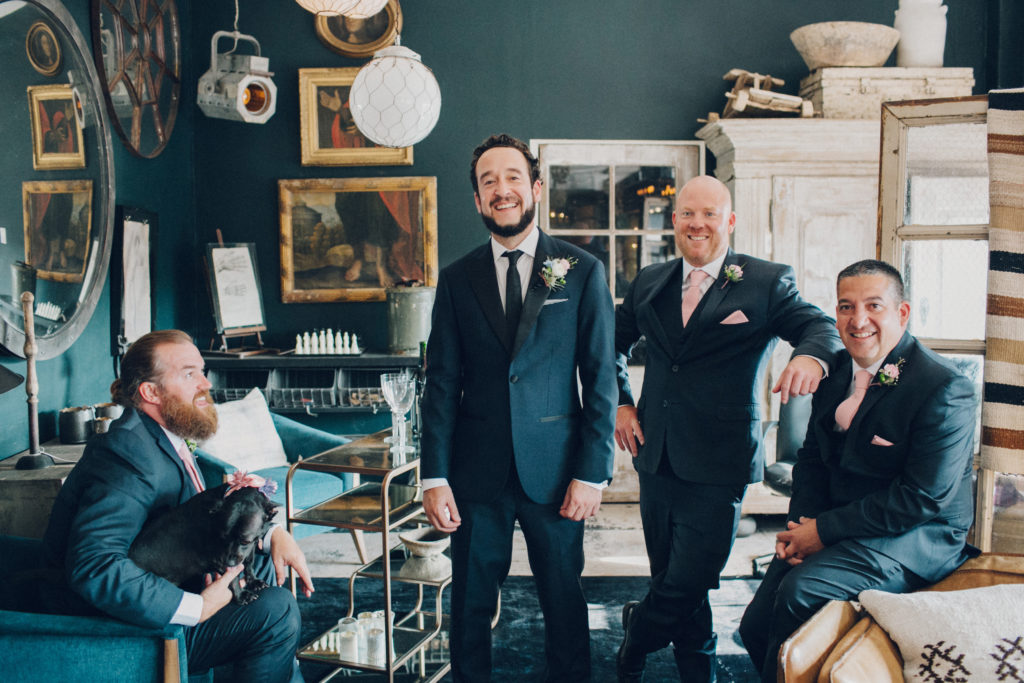 laid back groomsmen at big daddy's antiques eclectic wedding venue