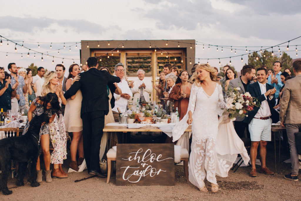 bride and groom with succulent wall desert wedding at moab under canvas desert