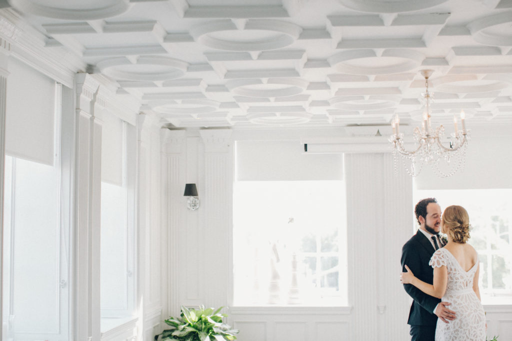 bride and groom in white culver hotel first look