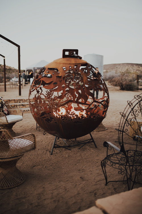 cool fire pit in desert at ruin venue