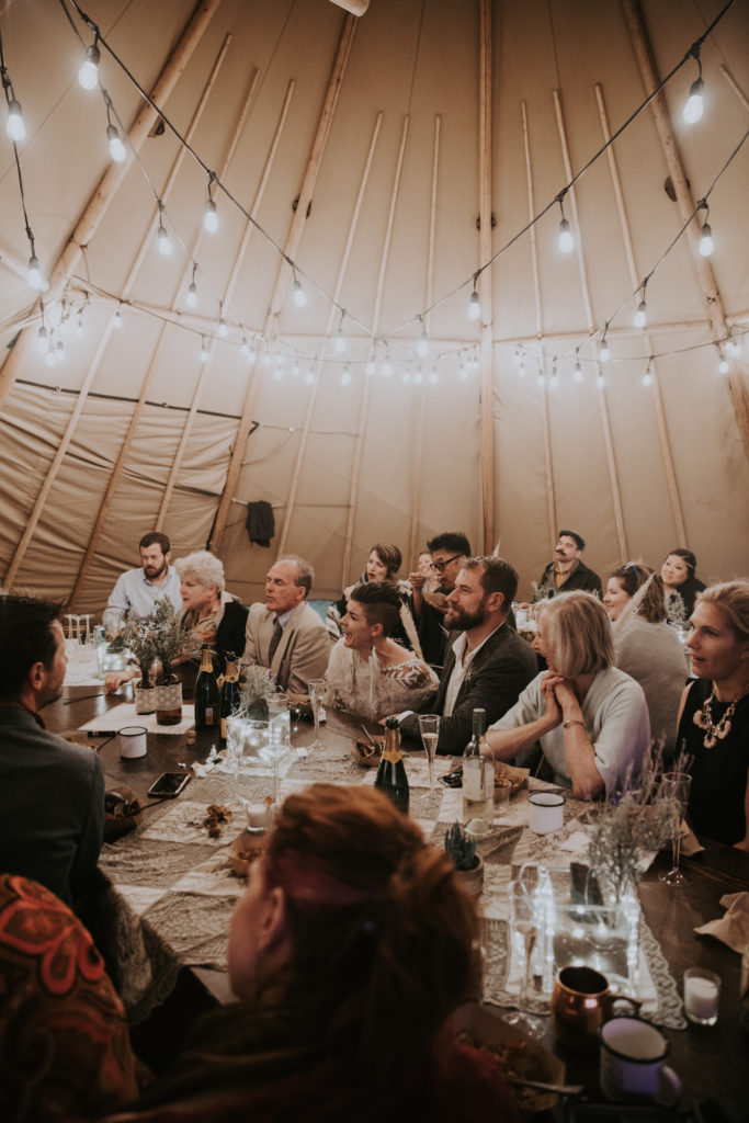 Inside a Stout teepee for an intimate wedding at Black rock desert. Burning man inspired wedding on The playa
