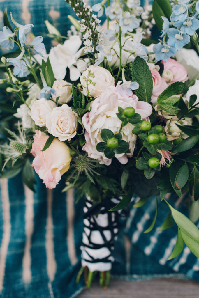 pink and blue bride bouquet with wrapped stem