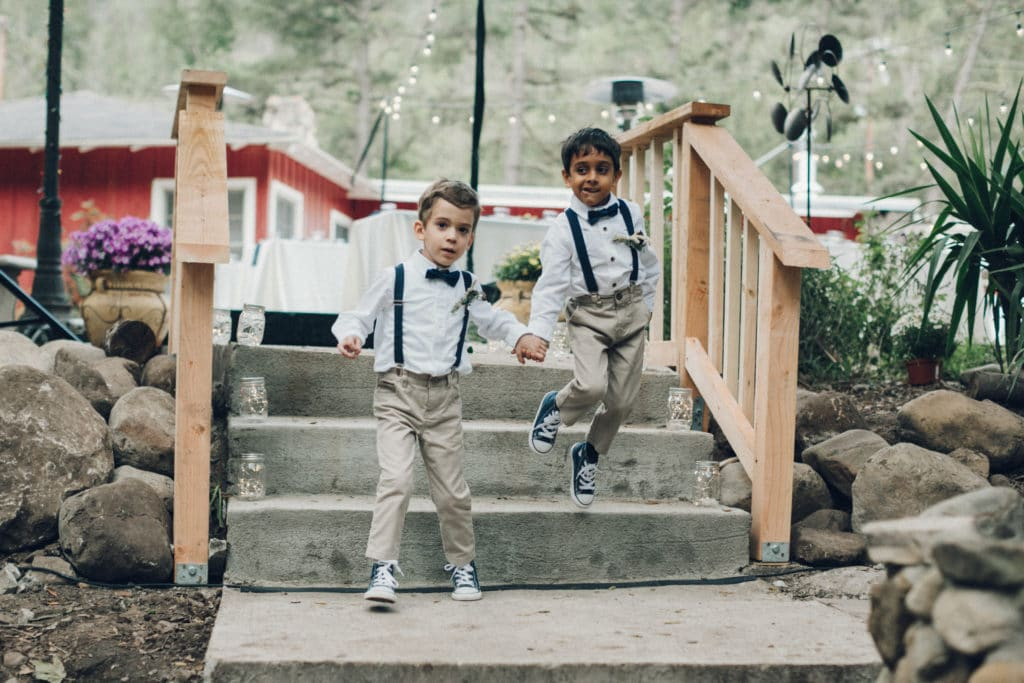 ring bearers with navy bowties and overalls