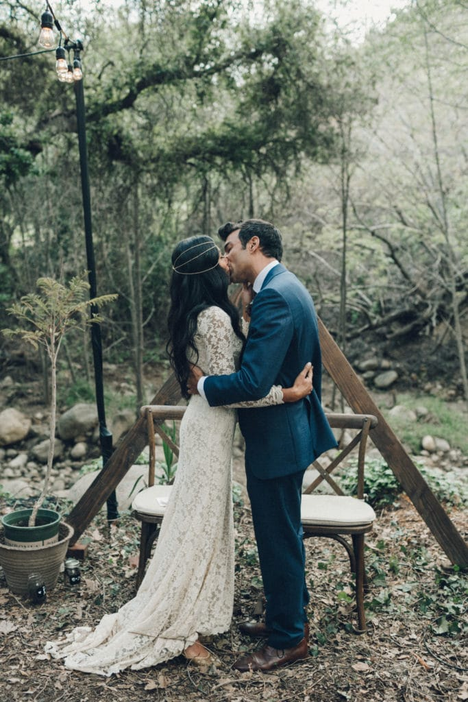 bohemian kiss in the woods wedding ceremony