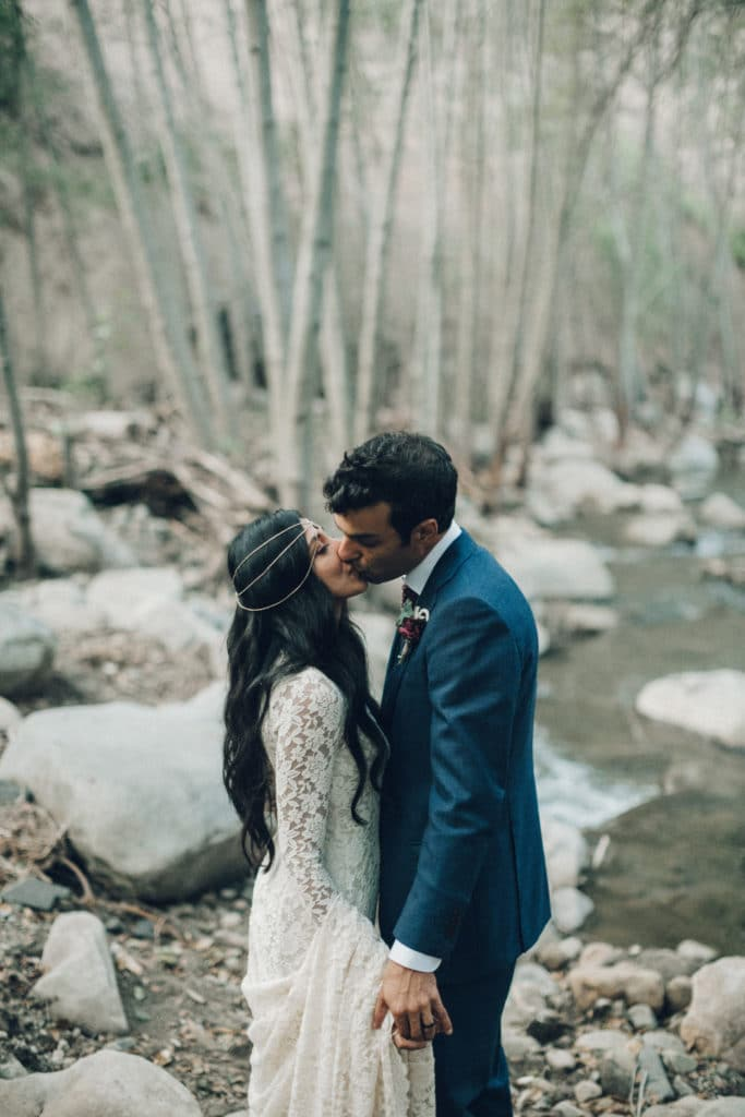 kiss in nature bohemian wedding couple