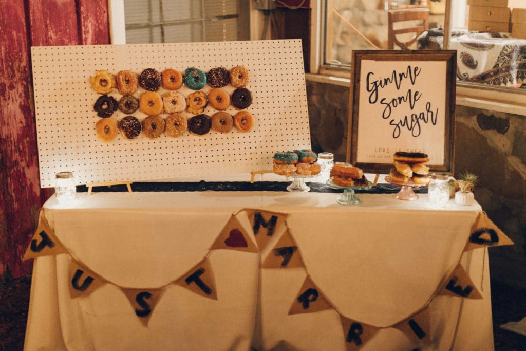 wedding donut wall and dessert sign