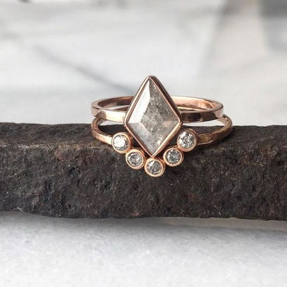 Unique diamond shape engagement ring with nesting band
