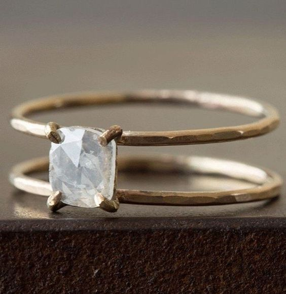 modern engagement ring with dainty band and raw diamond