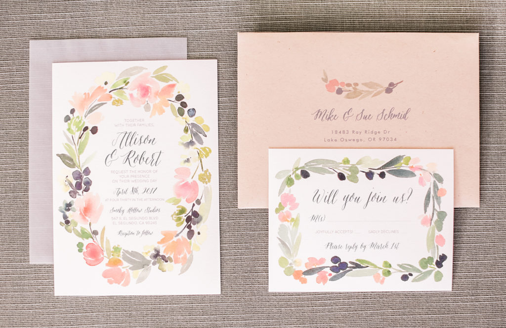 invitation suite with soft pinks, greens and ivory