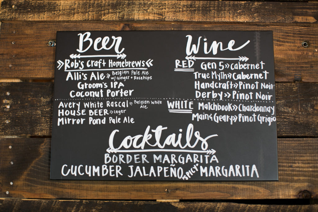 chalkboard drink menu on wooden wall